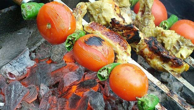 Jujeh kabab is one of the most famous Persian dishes. It consists of pieces of chicken first marinated in minced onion and lemon juice with saffron then grilled over a fire. It is sometimes served with grilled tomato and pepper. (Source: Wikipedia)